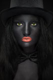 Beautiful portrait of woman in hat with black skin stock photo