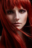 Beautiful portrait of woman with red hair Stock Photo