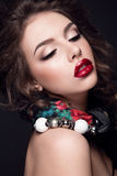 Beautiful portrait of woman with red lips and with jewelry on neck. Russian beauty Stock Photography