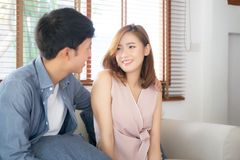 Beautiful portrait young asian couple relax and satisfied together in living room at home, family sitting couch. Confident with cheerful and happy with royalty free stock photo