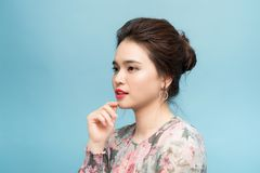 Beautiful portrait young asian woman confident thinking over blue background stock photography