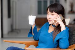 Free Beautiful Portrait Young Asian Woman Smiling Using Mobile Smart Phone Talking Enjoy And Drink Coffee With Relax Stock Photography - 144546552