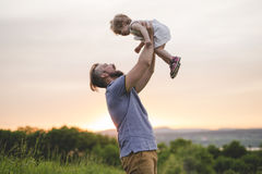 Beautiful portrait of young attractive father with daughter toddler stock photography