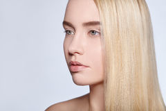 Beautiful portrait of a young blonde girl with straight hair Stock Photography