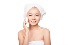 Beautiful portrait of young girl applying makeup on her face. Isolated on white background Royalty Free Stock Photos