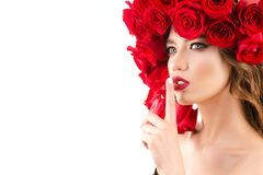 Beautiful portrait young girl with hairstyle from red roses royalty free stock photos