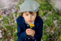 Beautiful portrait of a young preschool child holding flower Stock Image