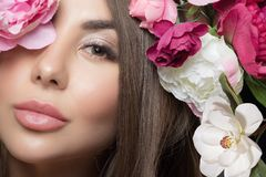 Beautiful portrait of a young woman. Flowers stock photos