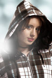 Beautiful portrait of young woman in hoody Stock Photography