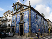 Beautiful Portuguese blue ceramic tile church with bell tower on corner in Porto, Portugal. Stock Photography