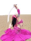 Beautiful pose of arab dancing at desert. Arab dancer posing with a sword at desert Stock Photography