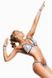 Beautiful posing sporty woman in bikini Royalty Free Stock Photography