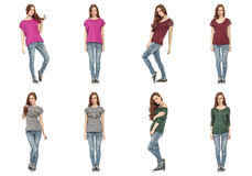 Beautiful posing young twins posing in jeans isolated on white Royalty Free Stock Photography