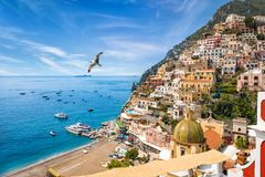 Beautiful Positano, Amalfi Coast in Campania, Italy. Beautiful Positano with colorful architecture on hills leading down to coast, comfortable beaches and azure royalty free stock image
