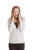 Beautiful positive and casual woman expressing surprise. Stock Photos