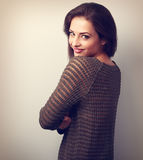 Beautiful positive casual woman in warm sweater looking happy Stock Images