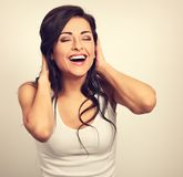 Beautiful positive excited laughing young woman holding the hand Royalty Free Stock Photos
