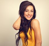 Beautiful positive happy laughing woman in yellow shirt with too Royalty Free Stock Photos