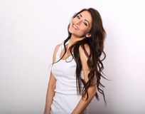 Beautiful positive laughing young woman in white shirt and tooth Stock Images