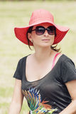 Beautiful positive woman in a red hat Royalty Free Stock Photos