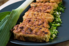 Beautiful potato patties with herbs and onions. Fresh beautiful potato patties with herbs and onions Stock Photography