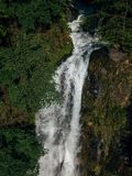 Beautiful and powerful waterfall Jirhwa in Abkhazia, aerial view royalty free stock photography