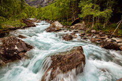 Beautiful powerful waterfall in Norway with the effect of flowin Royalty Free Stock Photo
