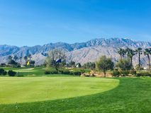 A beautiful practice area in Palm Springs, California, United States. The chipping green has a bunch of golf balls by the hole stock photo