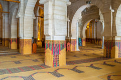 The beautiful prayer hall. SOUSSE, TUNISIA - SEPTEMBER 6, 2015: The medieval stone prayer hall with many rows separated by arcades in Grand Mosque, on September Stock Images