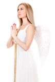 Beautiful praying young woman in a white dress with angel wings Stock Photography