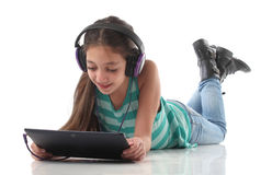 Beautiful pre-teen girl on the floor Royalty Free Stock Images