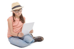 Beautiful pre-teen girl with a tablet computer. A beautiful pre-teen girl with a tablet computer Royalty Free Stock Images