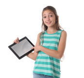 Beautiful pre-teen girl with a tablet computer. Isolated. Clipping path for the screen Royalty Free Stock Photos