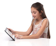 Beautiful pre-teen girl with a tablet computer. Isolated. Clipping path for the screen Stock Image