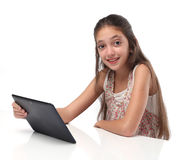 Beautiful pre-teen girl with a tablet computer. Isolated. Clipping path for the screen Stock Photography