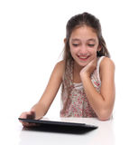 Beautiful pre-teen girl with a tablet computer. Royalty Free Stock Photos