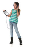 Beautiful pre-teen girl using a tablet computer. And headphones. Isolated Stock Photos