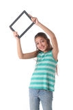 Beautiful pre-teen girl using a tablet computer. Beautiful pre-teen girl with a tablet computer. Isolated. Clipping path for the screen Stock Photos