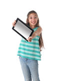 Beautiful pre-teen girl using a tablet computer. Beautiful pre-teen girl with a tablet computer. Isolated. Clipping path for the screen Royalty Free Stock Photos