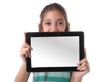 Beautiful pre-teen girl using a tablet computer. Beautiful pre-teen girl with a tablet computer. Isolated. Clipping path for the screen Royalty Free Stock Photography