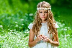 Beautiful pre teen in green field. Royalty Free Stock Photos