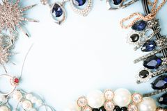Beautiful precious shiny jewelery trendy glamorous jewelry set, necklace, earrings, rings, chains, brooches with pearls royalty free stock image