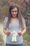 Beautiful pregnant brunette in nature Stock Image