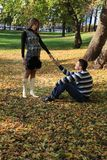Beautiful pregnant couple in autumn park Stock Photo