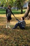 Beautiful pregnant couple in autumn park. Beautiful young happy couple in autumn park Stock Photo
