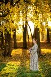 Beautiful Pregnant female in autumn Stock Photos