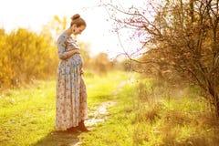 Beautiful Pregnant female in autumn Stock Photo
