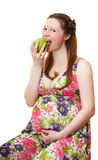 Beautiful pregnant girl with apple. Stock Images