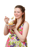 Beautiful pregnant girl with cake. Royalty Free Stock Image