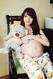 Beautiful pregnant girl with dark hair photo Royalty Free Stock Image